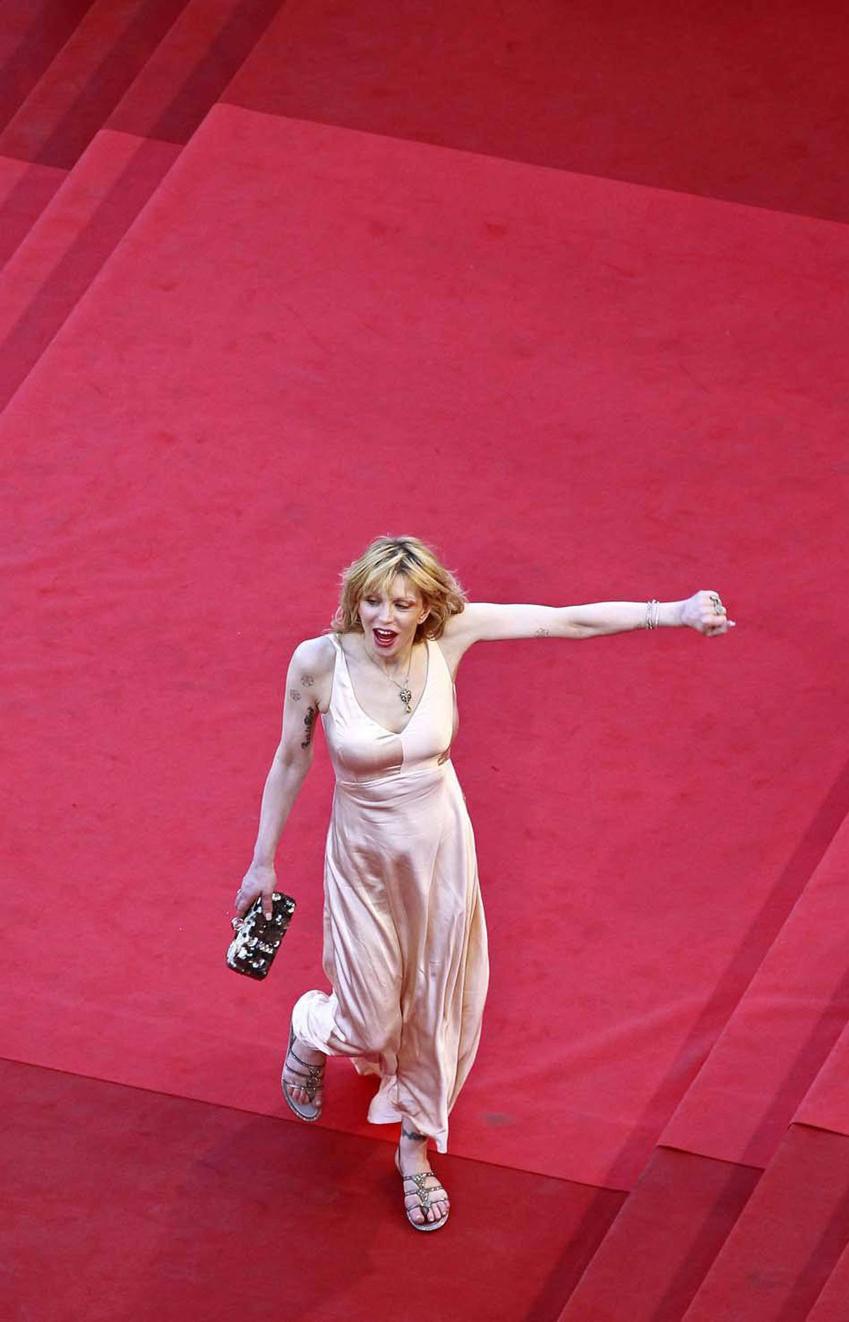 "Courtney Love strays off-line as she arrives for the screening of the film ""This Must Be The Place"" at the Cannes Film Festival on Friday."