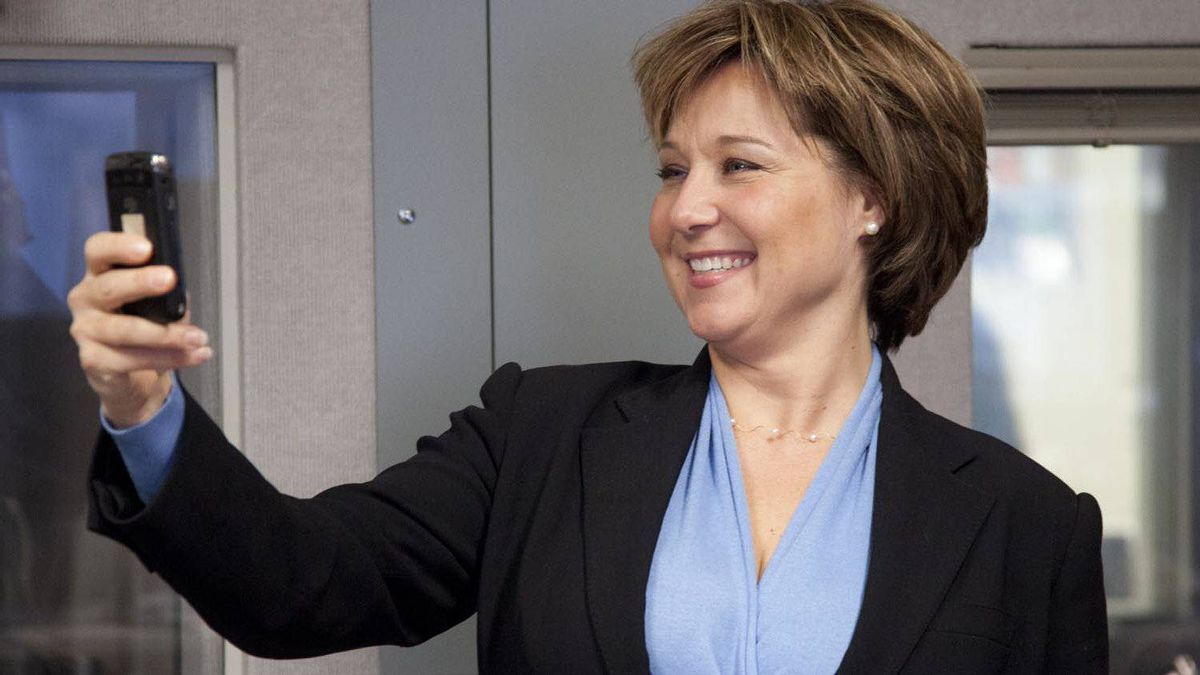 British Columbia Premier Christy Clark takes a photo of the media with her blackberry in downtown Vancouver on Monday.