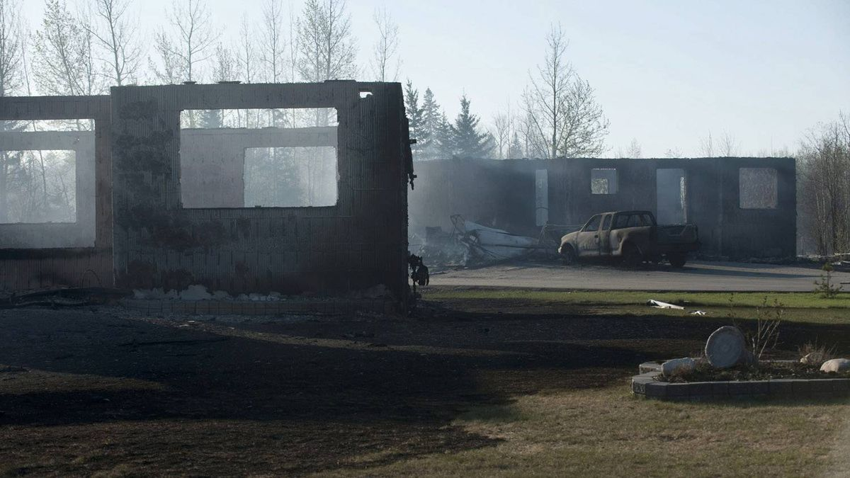 The smouldering remains of houses outside Slave Lake, Alta., on Monday May 16, 2011. A firestorm swept through the town of 7,000 destroying upwards of 30 percent of the buildings.