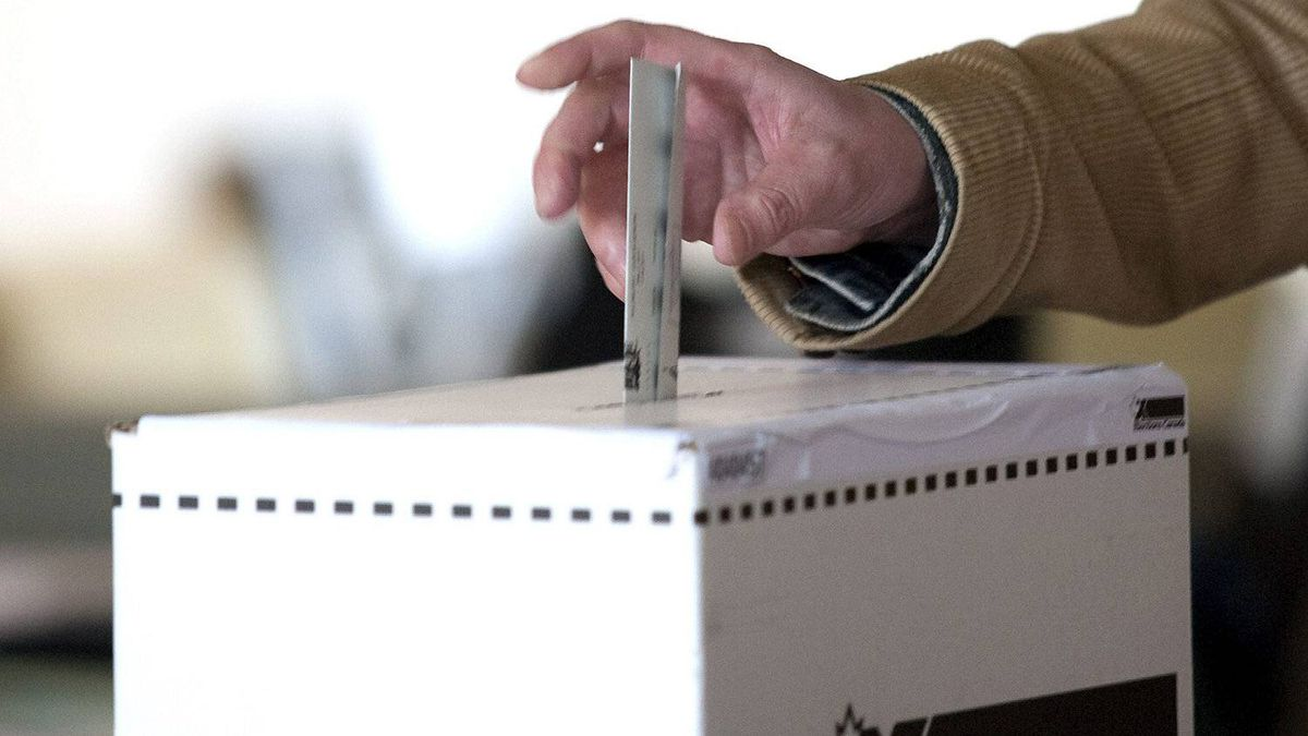 A man casts his vote for the federal election in a polling station on Toronto's Ward Island on Monday, May 2, 2011.