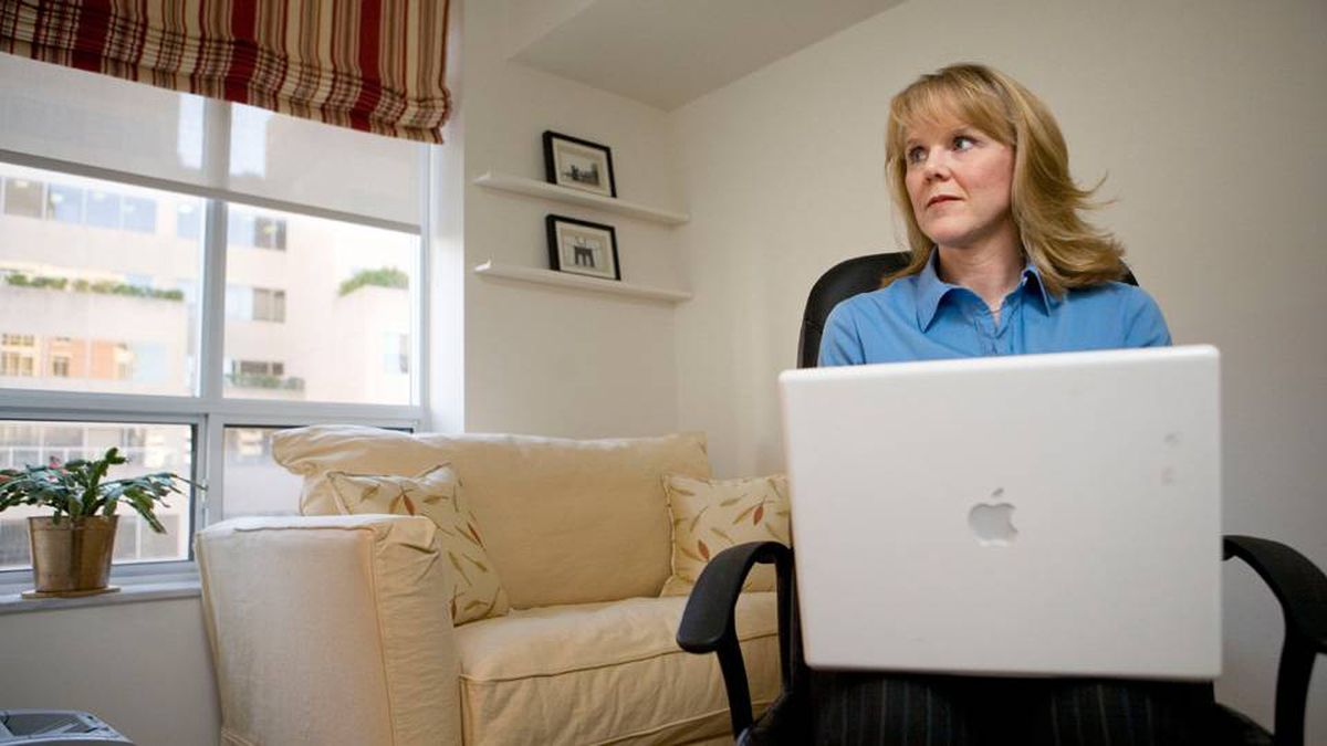 Self employed consultant Tracey White is seen working in her home office on November 6, 2009.