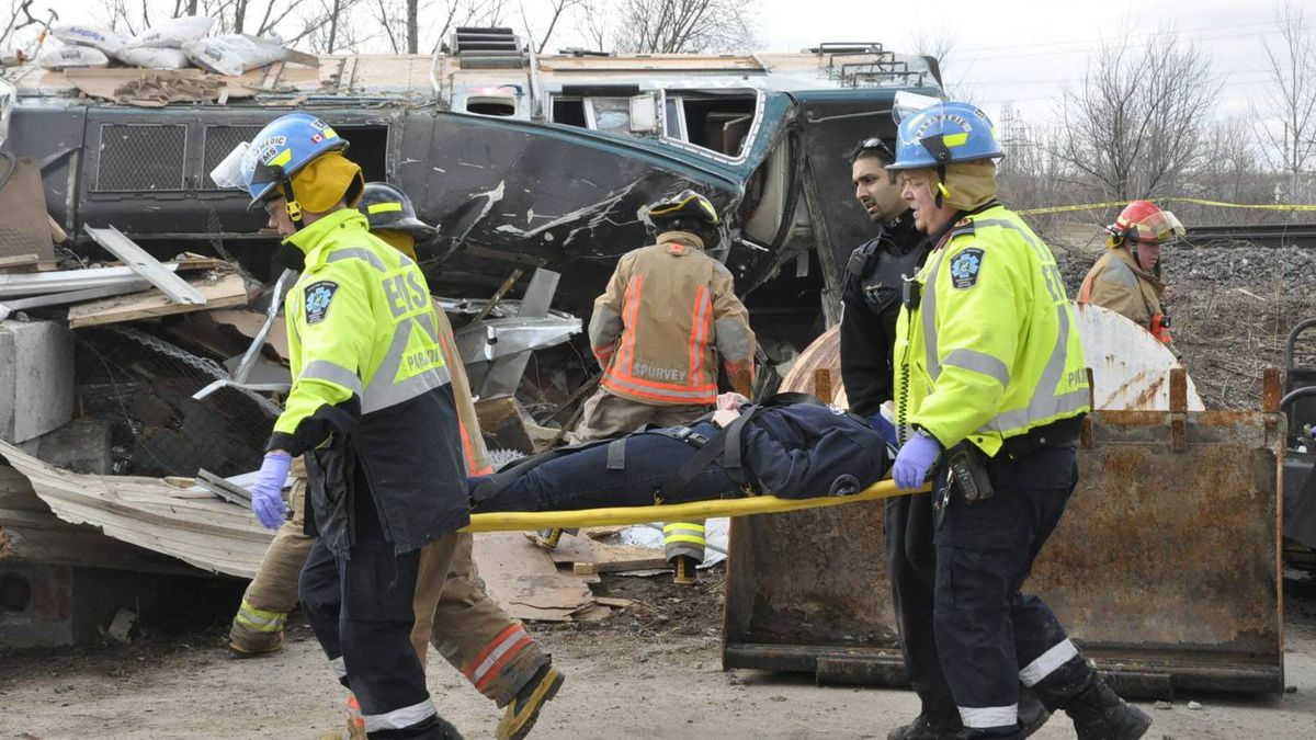 Emergency crew help passengers out of a train wreck in Burlington, Ont.