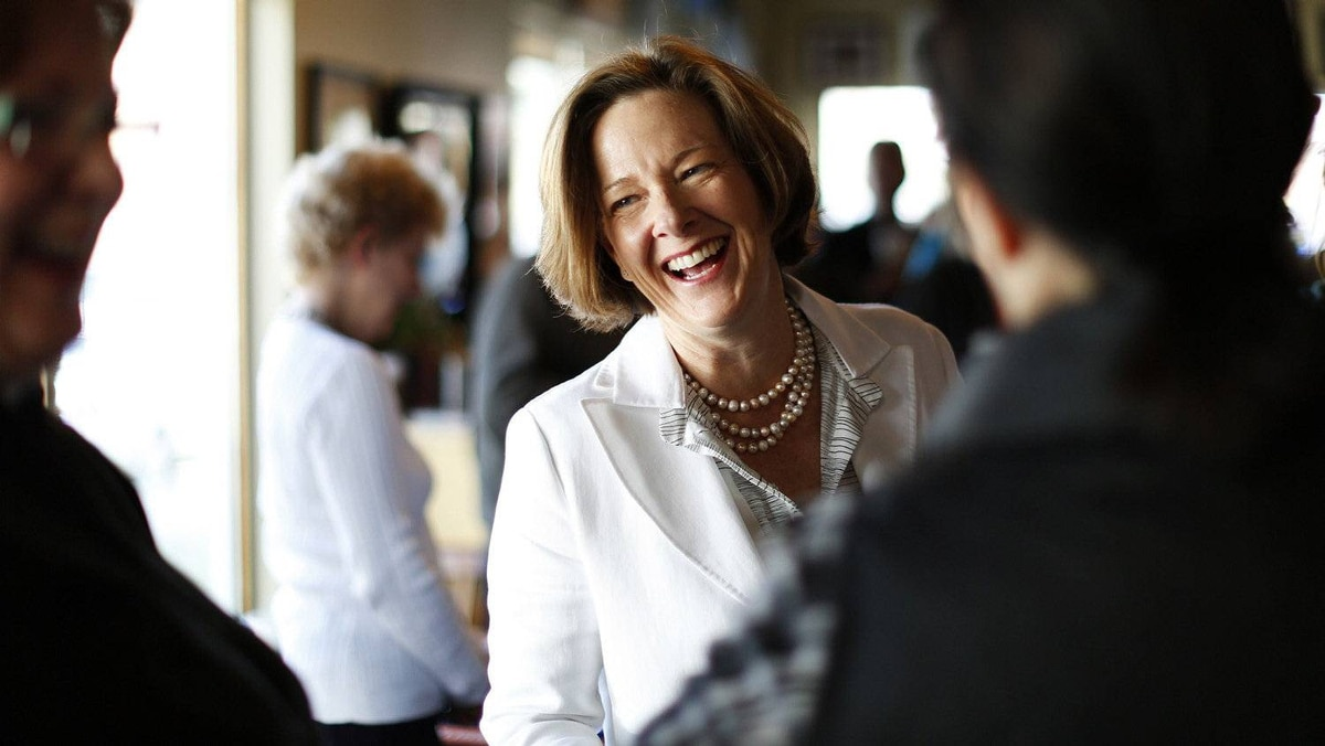 Progressive conservative party leader and Alberta premier Alison Redford (C) is greeted by supporters at a local coffee house during a campaign stop in Calgary, Alberta, April 22, 2012.