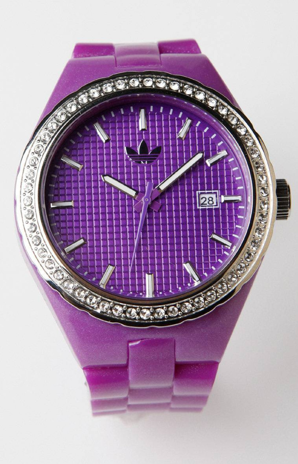 Adidas watch (large face lighter pink-purple), $95 at Adidas Originals (www.adidas.com)