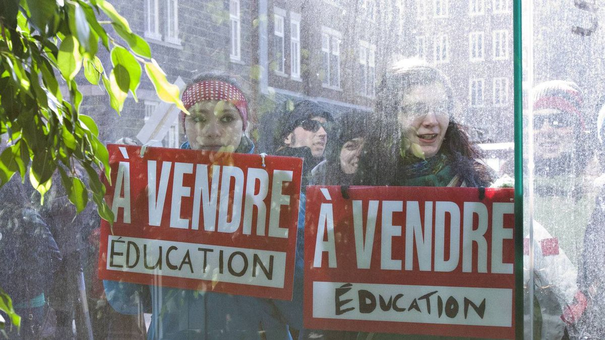 Students demonstrate outside the Marie-Guyart building which houses the Quebec Ministry of Education in a protest against tuition hikes Tuesday, March 27, 2012 in Quebec City.