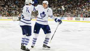 Dion Phaneuf #3 of the Toronto Maple Leafs celebrates with teammate Clarke MacArthur #16 of the Toronto Maple Leafs after MacArthur's second period power play goal against the Pittsburgh Penguins on October 13, 2010 at Consol Energy Center in Pittsburgh, Pennsylvania.