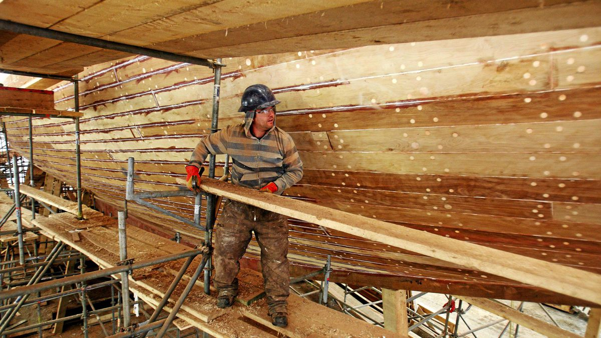 Scaffolding is taken down from the hull of the schooner Bluenose II after sanding of the planks was completed in Lunenburg, NS , Feb. 13 , 2012.