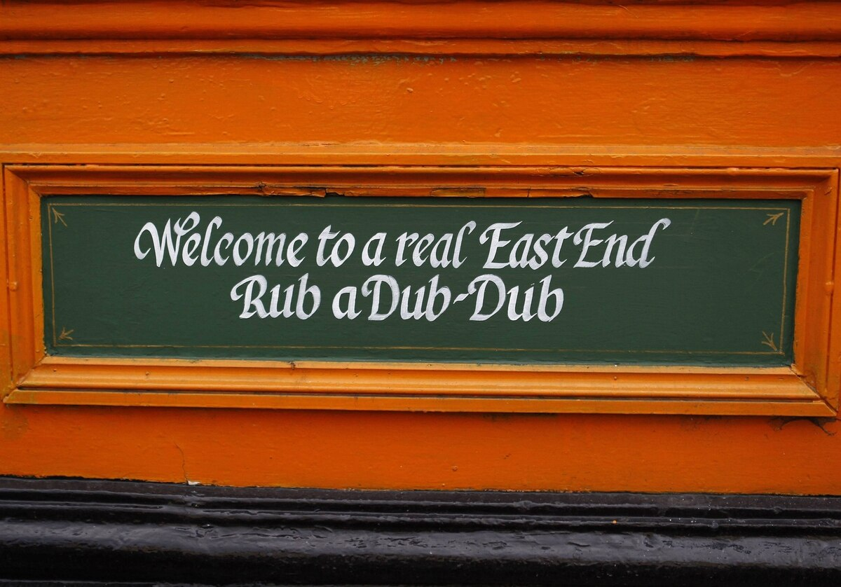 A sign is seen on the outside of the Bow Bells pub in east London. The sign reads 'rub a dub-dub', which is a Cockney rhyming slang for 'pub'.
