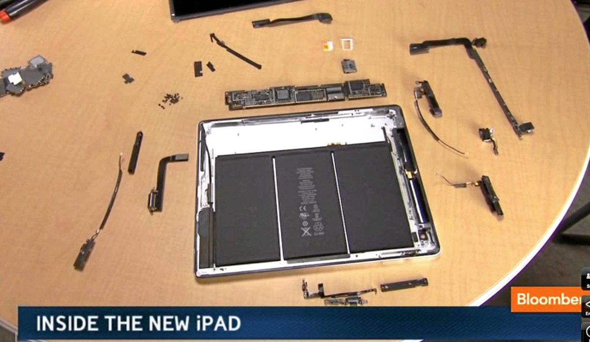 The iPad's black lithium-ion batteries are enclosed by aluminum, to help conduct and diffuse the heat generated by its powerful innards.