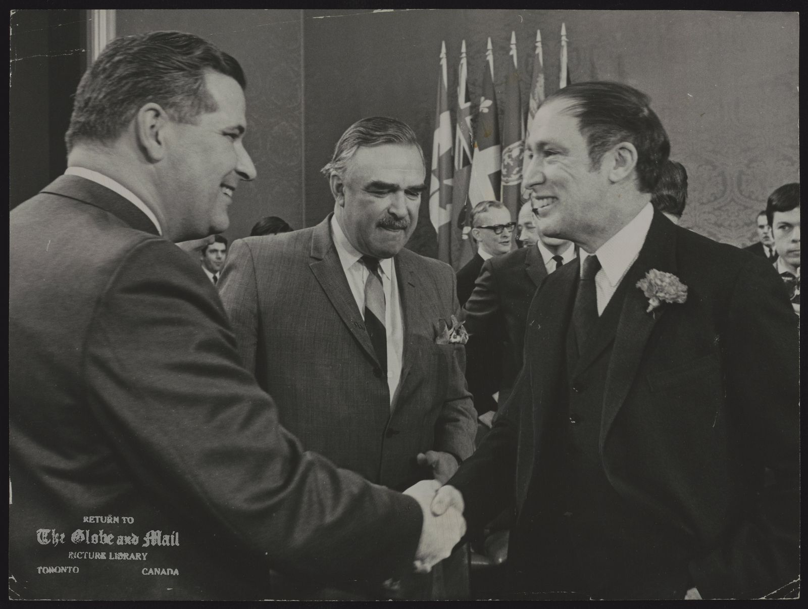 Pierre Elliott TRUDEAU Mantoba Premier Walter Weir with Premier John Robarts is greeted by Prime MInister Pierre Trudeau Mr. Weir later won his point. Financial problems will be discussed at today's session of the federal provincial talks