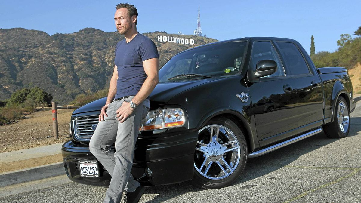 Actor Kevin Durand poses for photographs by his Ford Harley-Davidson F-150 100th Anniversary Edition in Los Angeles, October 18, 2011. __Ann Johansson for The Globe and Mail