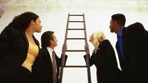 Business people looking up a ladder.
