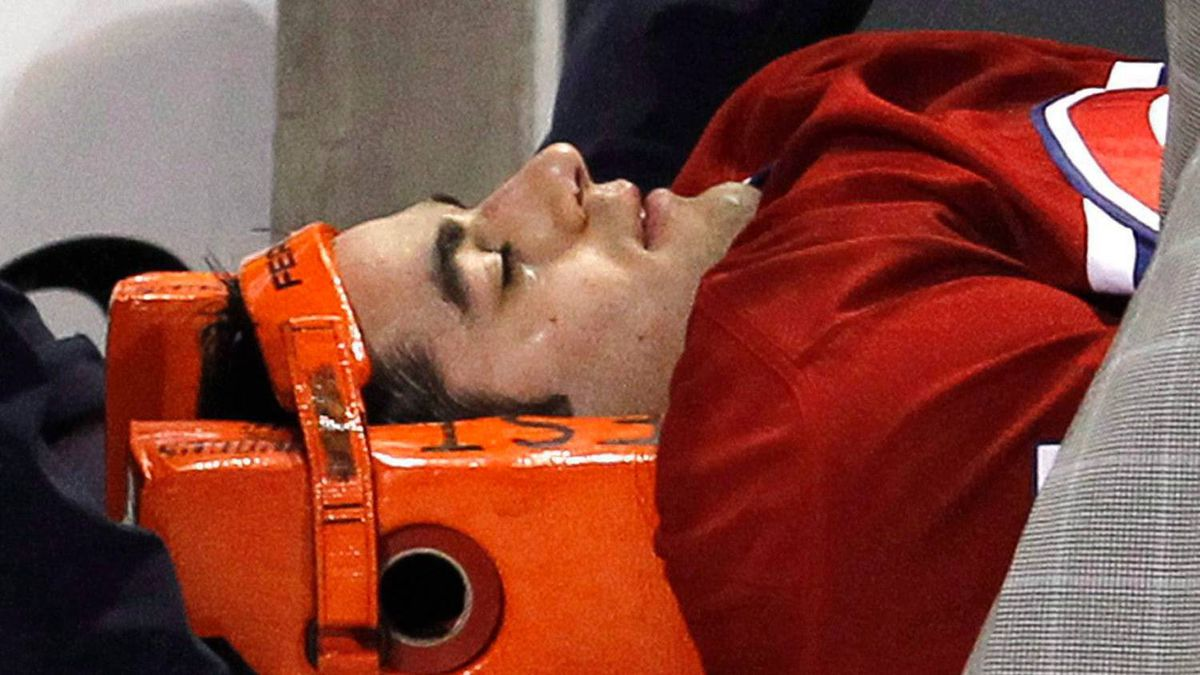 Montreal Canadiens' Max Pacioretty is shown being wheeled away on a stretcher after taking a hit by Boston Bruins' Zdeno Chara during second period NHL hockey action Tuesday, March 8, 2011 in Montreal.