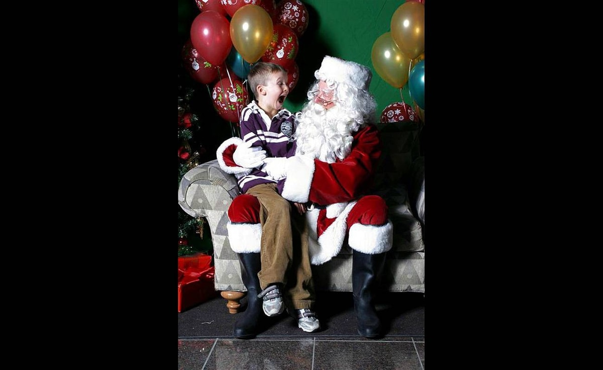 """Tasha Bridgen writes: """"My son was making faces while sitting on Santa's lap. Santa asked what he was doing and my son demonstrated."""