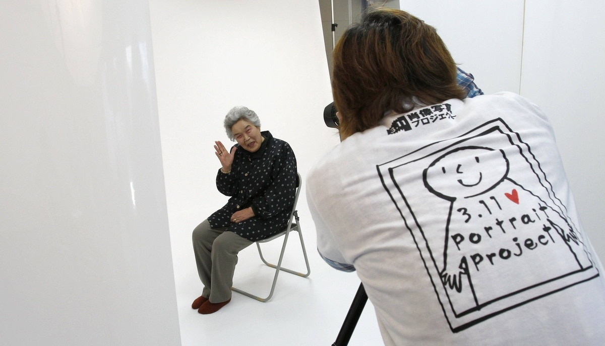 Photographer Kenichi Funada takes a portrait of Misako Yokota as part of the 3.11 Portrait Project. The project was conceived by photographer Nobuyuki Kobayashi who takes portraits of Japan's earthquake survivors. The portraits are then sent to schoolchildren from non-disaster areas, who frame the portraits and send them back to the survivors along with personal messages of support.