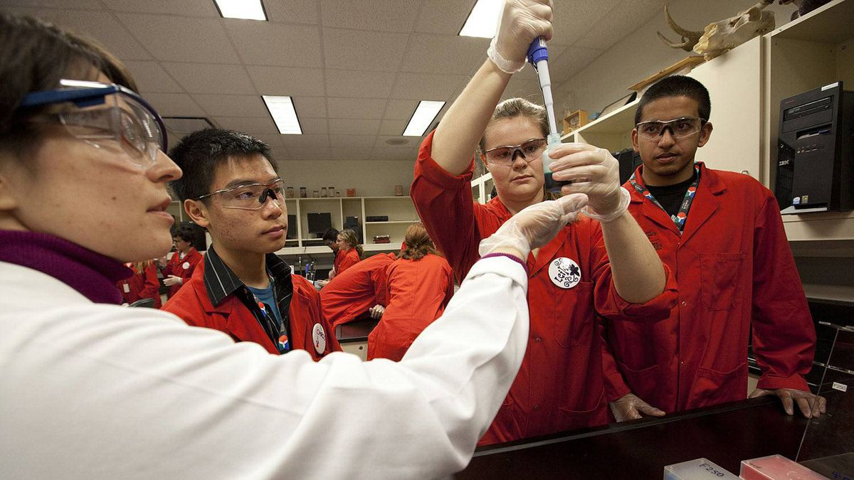 Teacher Magaret De Jesus shows Grade 12 biology students Chris Chung, Leila Meema-Coleman and Clinton D'Silva, how to use some equipment for an experiment at the Ontario Science Centre Science School in Toronto. The small school, takes on 30 dedicated students to learn about science.