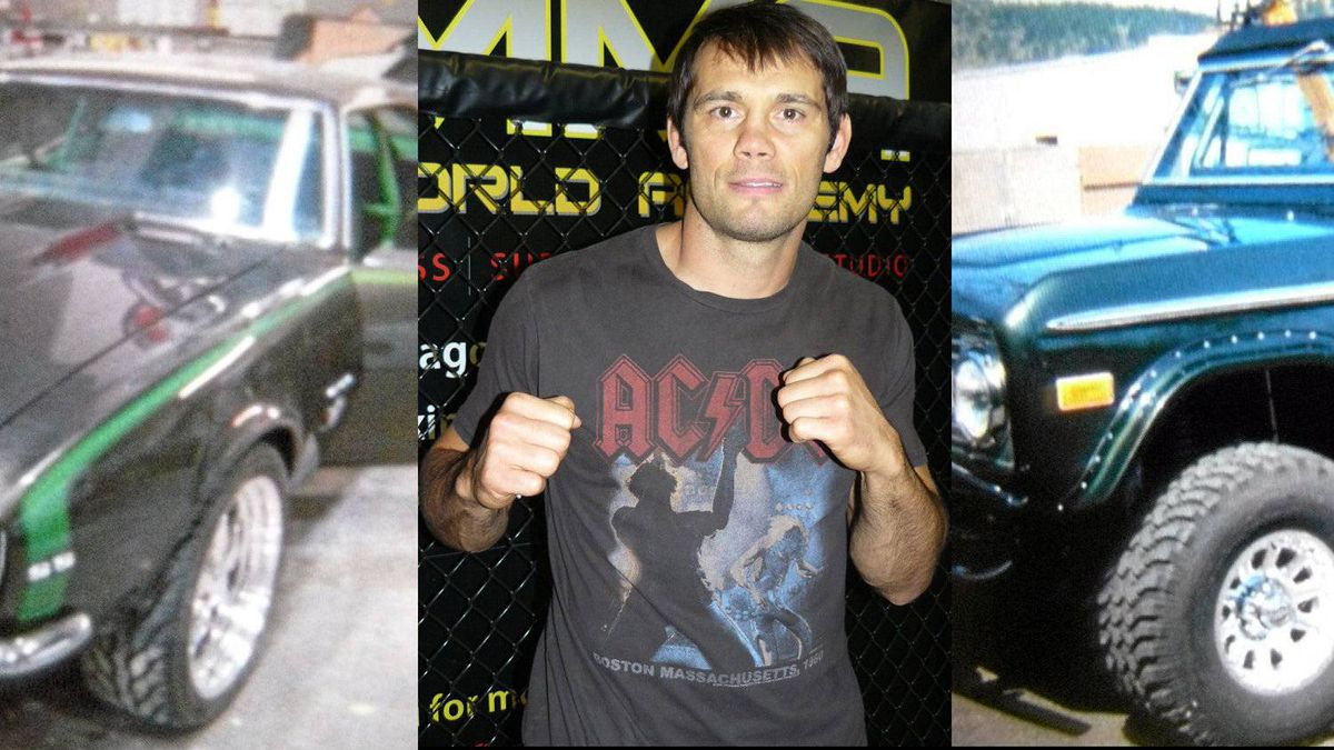 MMA fighter Rich Franklin flanked by his rides, a 1967 Chevy Camaro and a 1974 Ford Bronco.