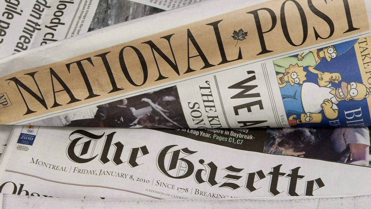 Some of Postmedia's newspapers are displayed in Ottawa on January 8, 2010. Postmedia Network Canada Corp. says it has filed a preliminary prospectus with regulators as it prepares to list its shares on the Toronto Stock Exchange.