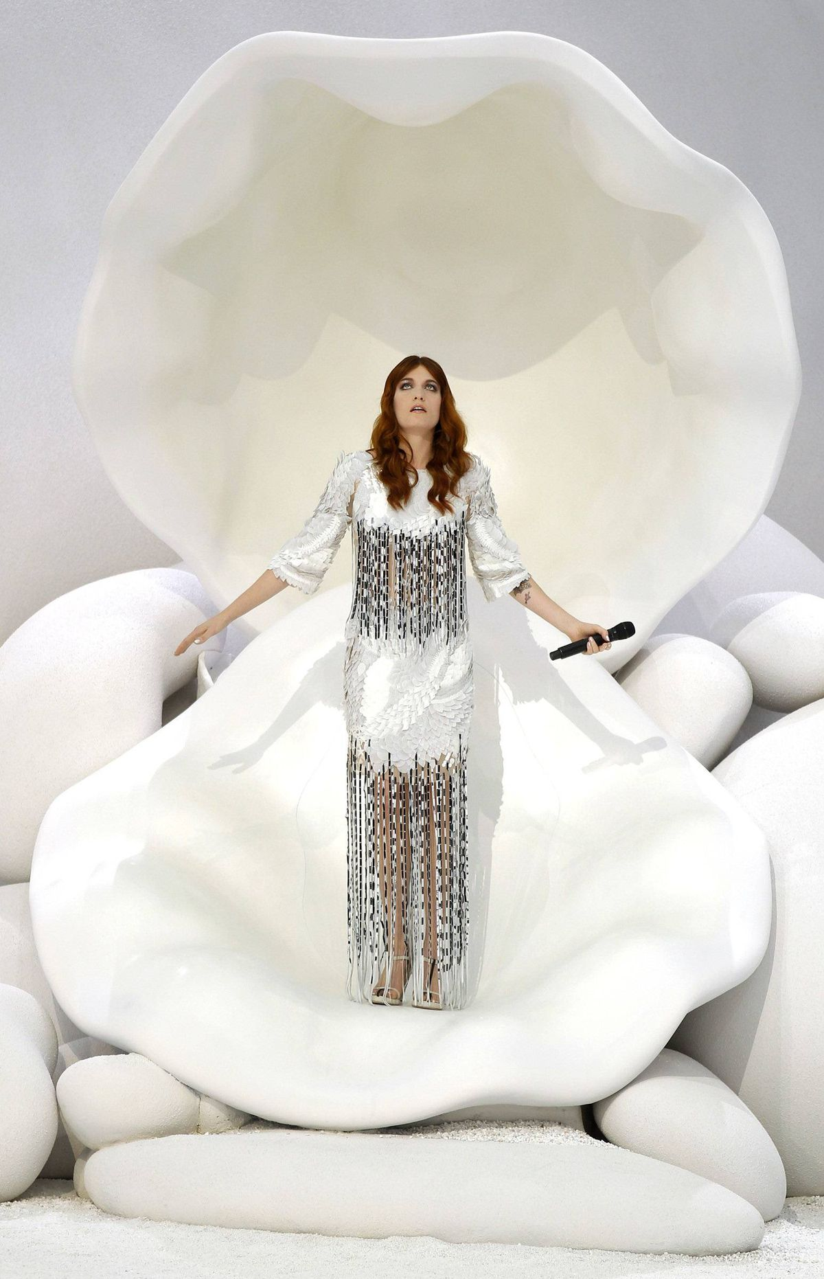 Hotshot chanteuse Florence Welch of Florence and the Machine belted out from a giant shell, Birth of Venus-style.