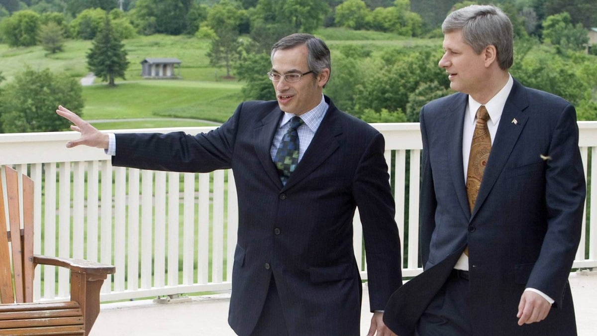 Prime Minister Stephen Harper tours the future grounds of the G8 summit in Huntsville with local Tory MP Tony Clement on June 19, 2008.