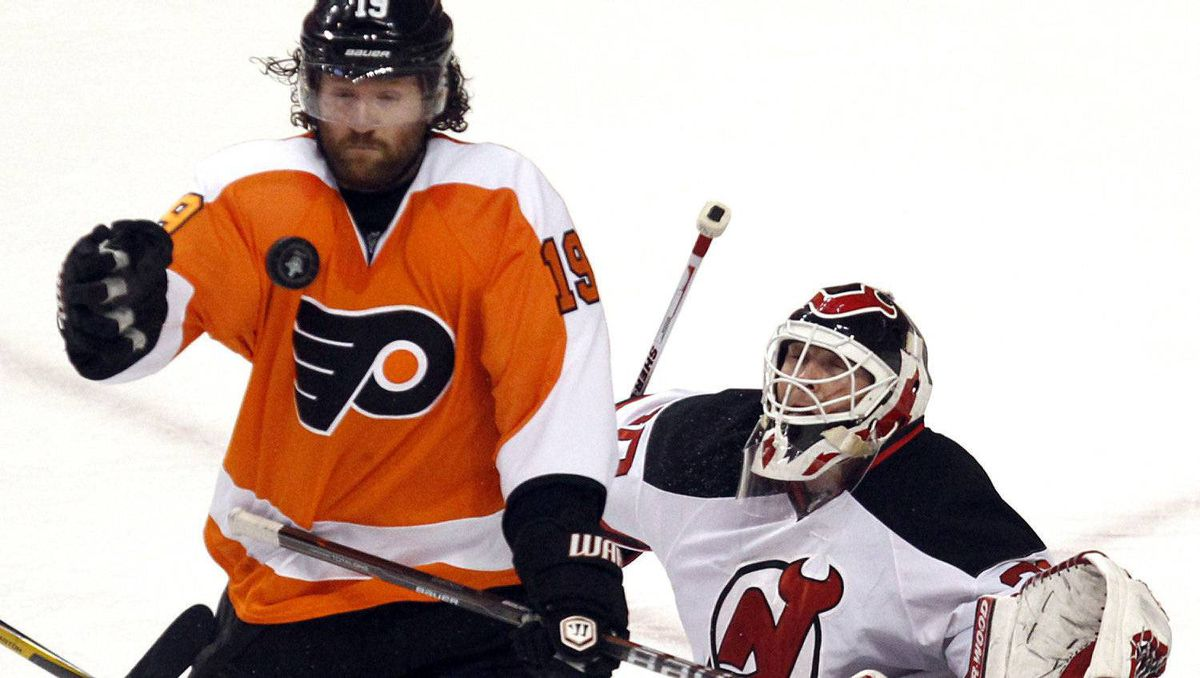 Philadelphia Flyers winger Scott Hartnell (19) reaches for the puck in front of New Jersey Devils goalie Martin Brodeur (30) during the first period in Game 1 of their NHL Eastern Conference semifinal playoff hockey series in Philadelphia, Pennsylvania April 29, 2012. REUTERS/Tim Shaffer