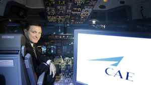 Marc Parent, president and CEO of CAE Inc., poses inside a flight simulator.