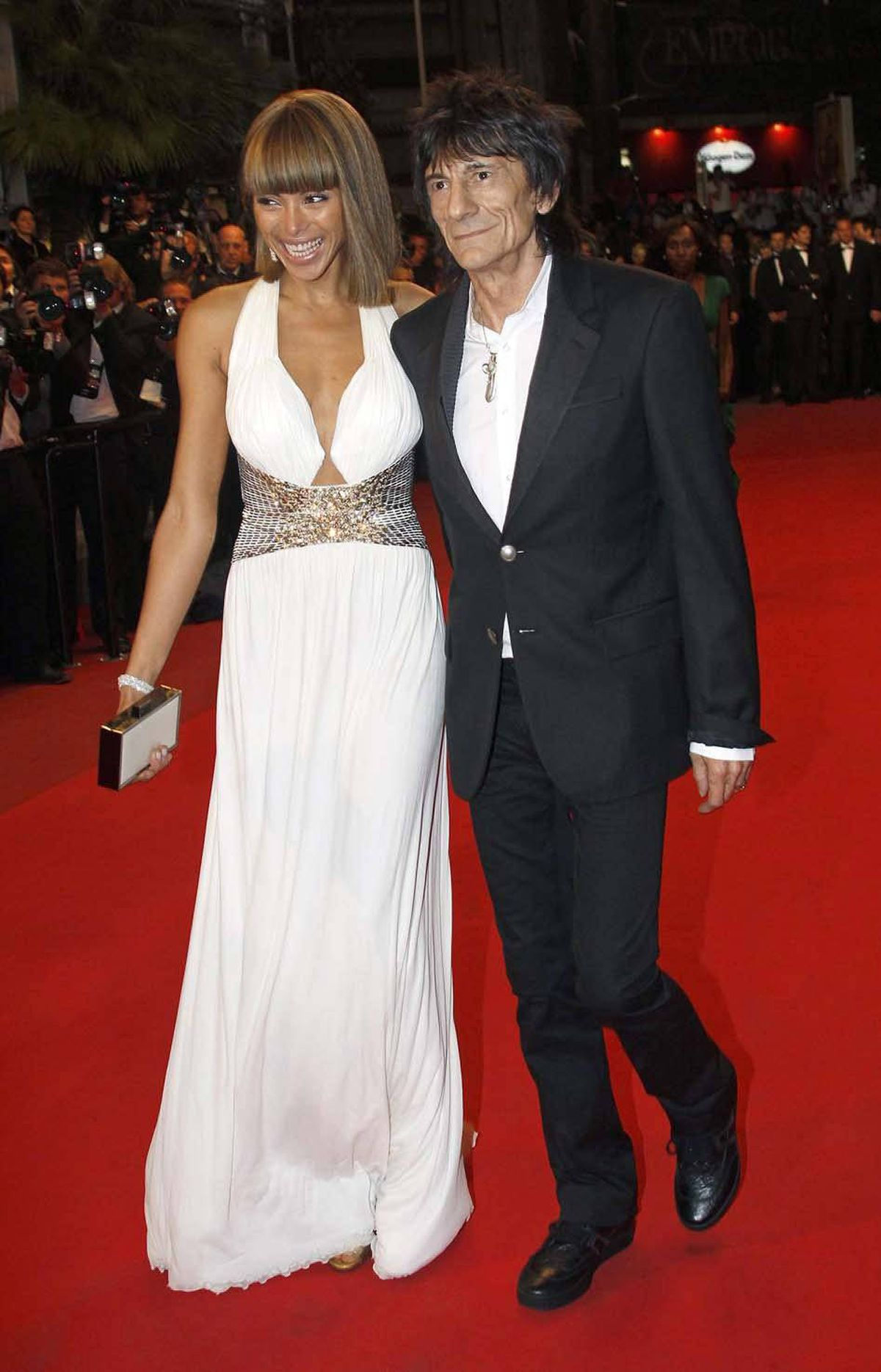 """Rolling Stones' guitarist Ron Wood and his girlfriend Ana Araujo on the red carpet for the screening of the film """"Melancholia"""" at the Cannes Film Festival on Wednesday."""