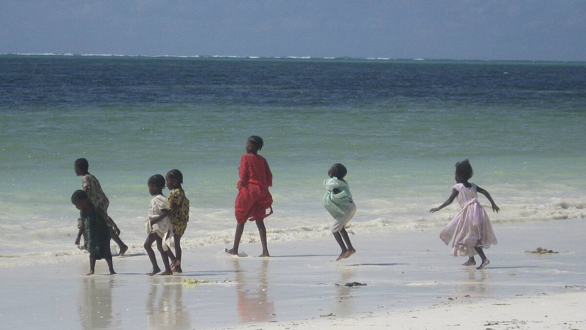 Katie Baglole photo: Playing in the Waves - Children at play on the coast of Zanzibar