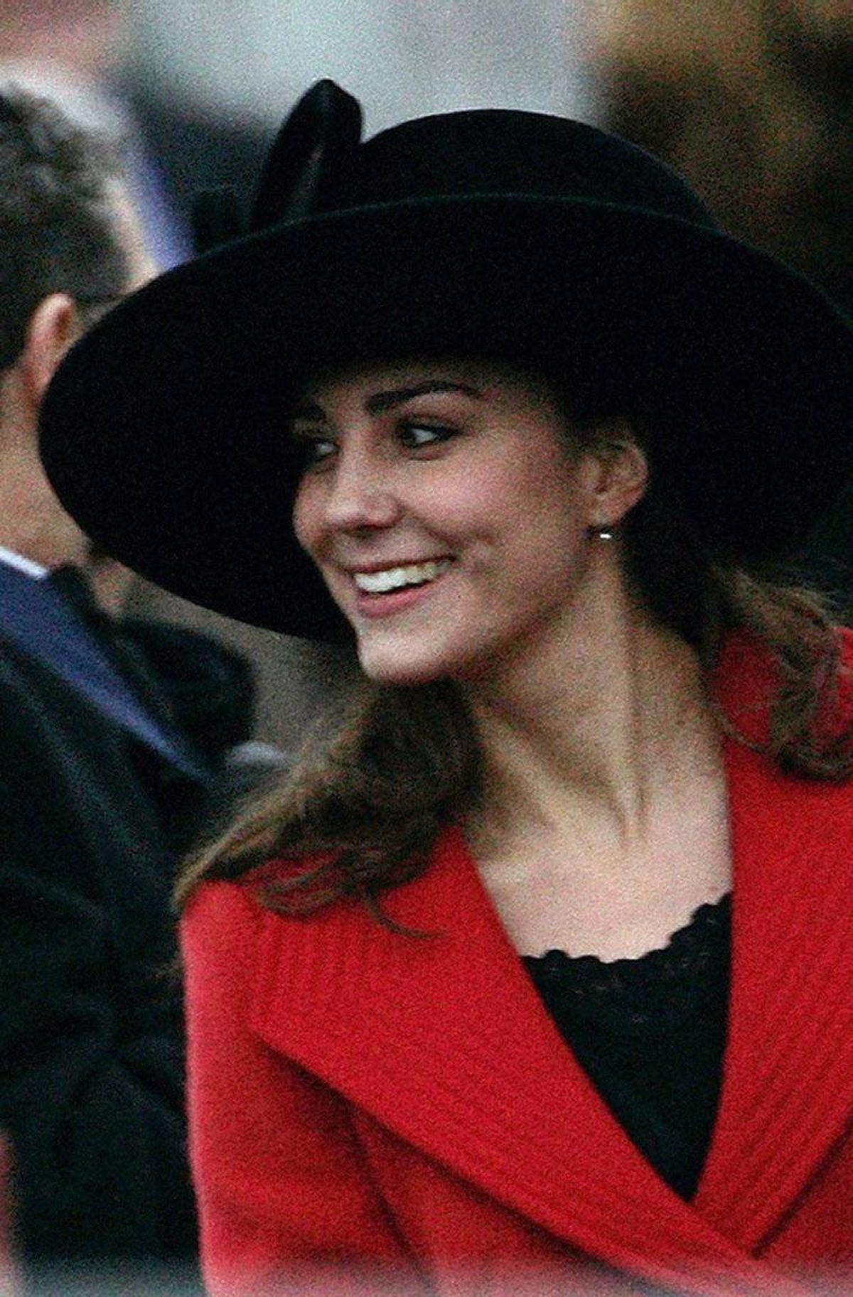 Kate Middleton smiles during the Sovereign's Parade at the Royal Military Academy in Sandhurst, southern England December 15, 2006.
