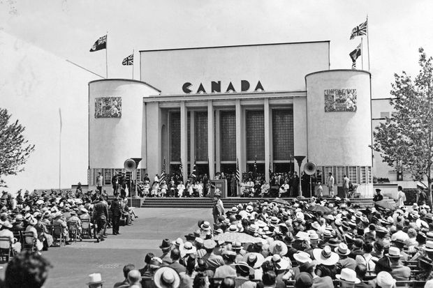 ab4e38e571f July 1, 1939: A crowd gathers for a ceremony at the opening of the Canadian  Pavilion at the New York World's Fair, whose slogan was 'The World of  Tomorrow.'