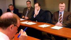 Keith Boag of the CBC (left-right) addresses Mike Robinson of the Liberal Party, Stephane Gobil of the Bloc Quebecois, Brian Topp with the NDP and Michael Coates with the Conservative party about the upcoming national debates in Ottawa Wednesday, Nov. 30, 2005