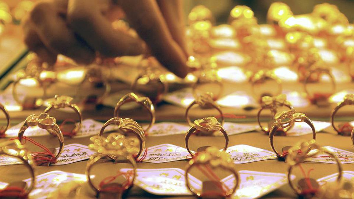A sales assistant arranges the gold rings at a store in Shenyang in northeast China's Liaoning province.