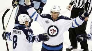 Winnipeg Jets Tim Stapleton congratulates teammate Alexander Burmistrov on his goal against the Pittsburgh Penguins in Pittsburgh, Feb. 11, 2012.