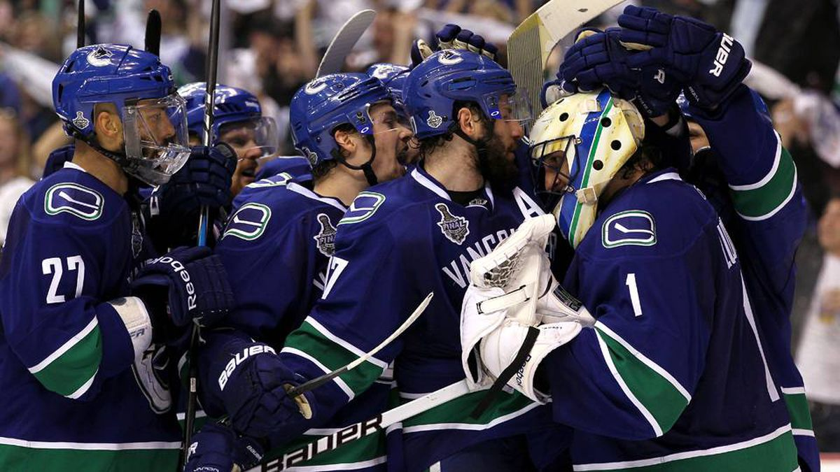 The Vancouver Canucks celebrate after defeating the Boston Bruins by a score of 1-0 in Game 5.