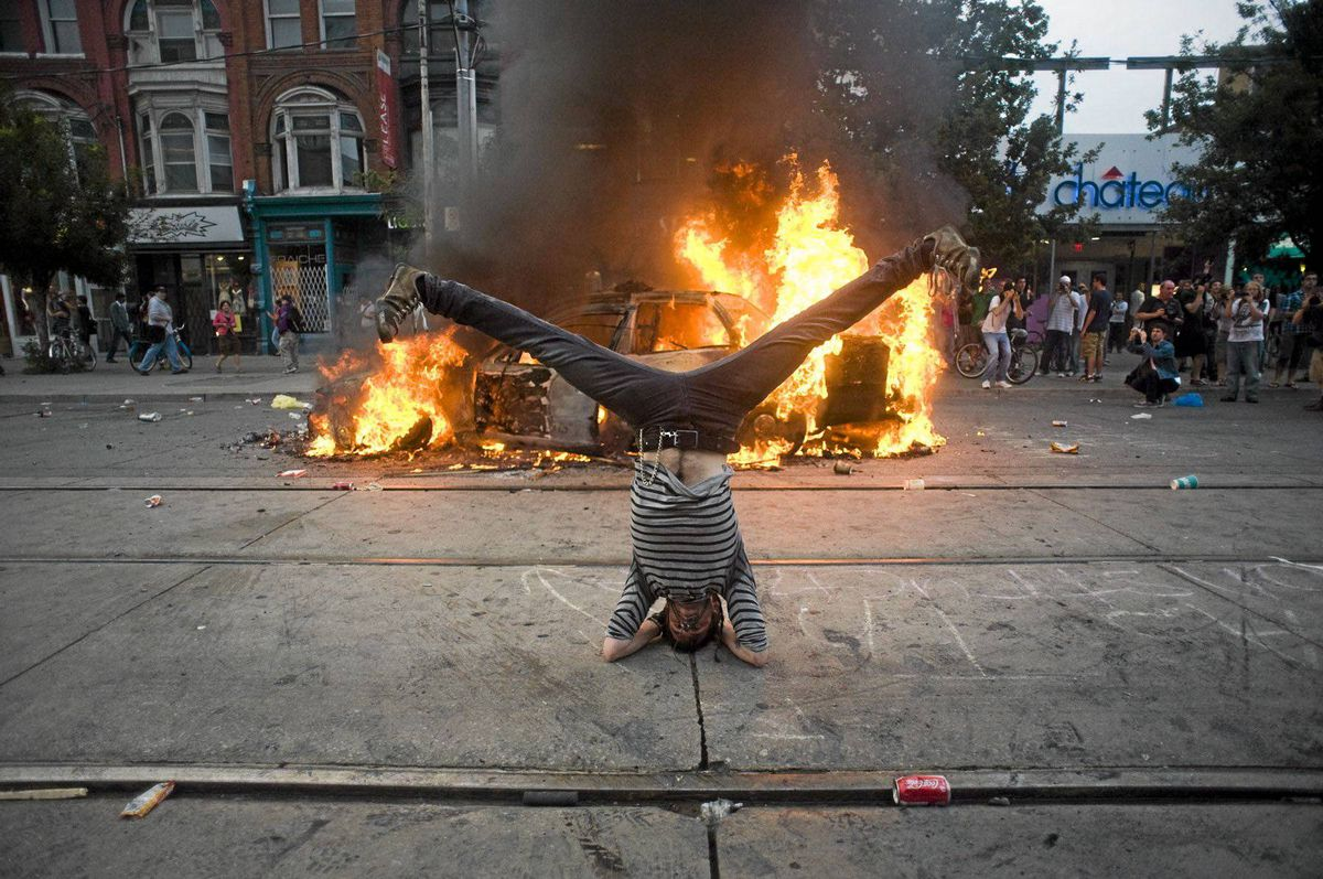 An acrobatic protester makes his statement on Queen Street West during G20 protests.