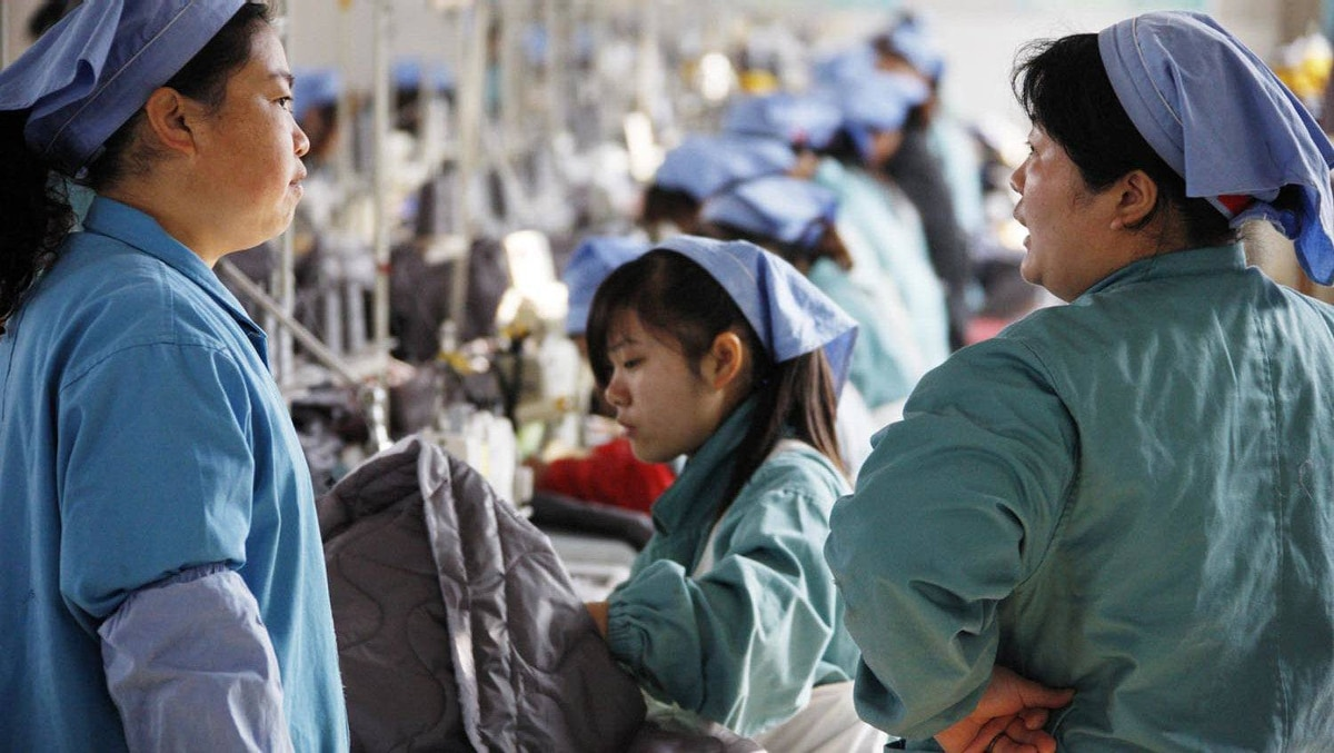 Workers are seen at a textile factory in Huaibei, in east China's Anhui province, on Nov. 21, 2011. China's manufacturing activity slumped to its lowest level in 32 months in November, banking giant HSBC said, renewing fears the Asian powerhouse is losing steam amid global economic woes.