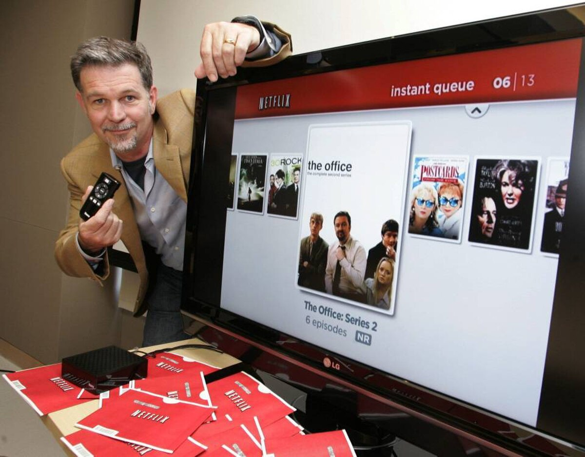 Netflix CEO Reed Hastings shows off the company's set top box at Netflix headquarters in Los Gatos, Calif.