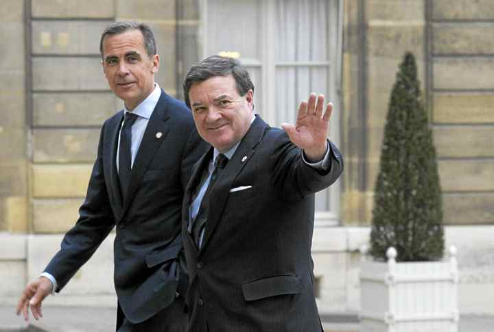 Bank of Canada Mark Carney, left, and Finance Minister Jim Flaherty arrive for a meeting at the Elysee Palace in Paris on Thursday