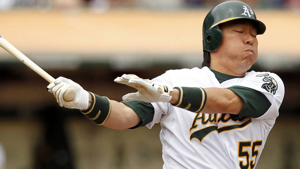 Oakland Athletics batter Hideki Matsui swings and misses during the first inning. REUTERS/Beck Diefenbach