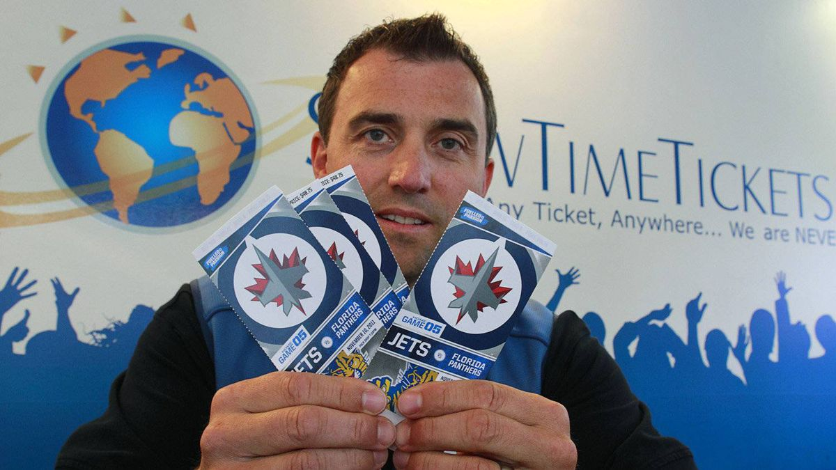 Mario Livich, a ticket broker with Show Time Tickets, holds up a batch of tickets to a Winnipeg Jets game in his offices in Vancouver October 11, 2011. The Jets franchise is putting new restrictions on ticket scalping.