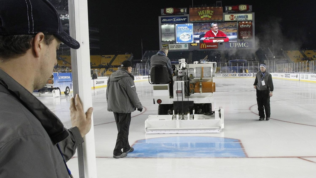 Crews prepping the ice close the doors behind the zamboni as final ice preparations are made before the NHL Winter Classic outdoor hockey game between the Pittsburgh Penguins and the Washington Capitals in Pittsburgh on Saturday, Jan. 1, 2011. (AP Photo/Keith Srakocic)