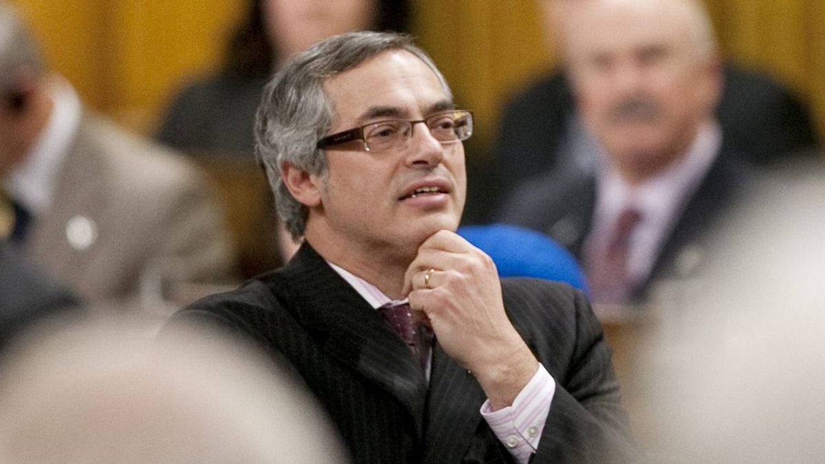 Treasury Board President Tony Clement stands in the House of Commons during Question Period on Nov. 14, 2011.