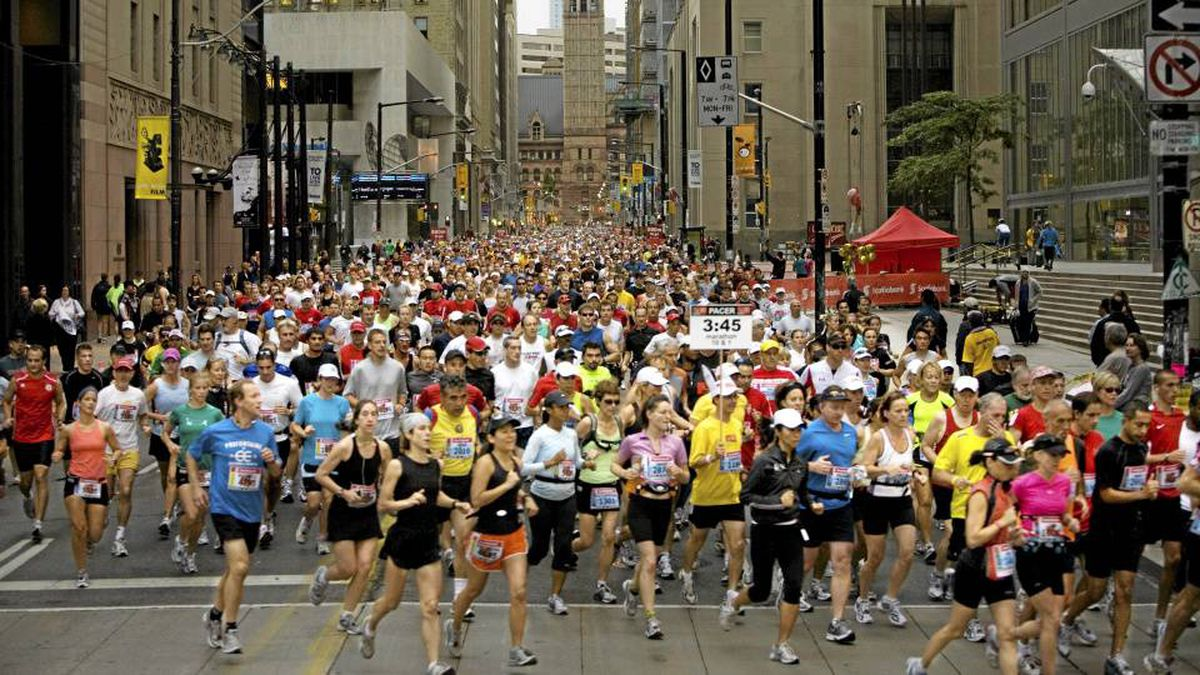Thousands of people ran down Bay Street at the start of the Scotiabank Toronto Waterfront Marathon on September 28, 2008.