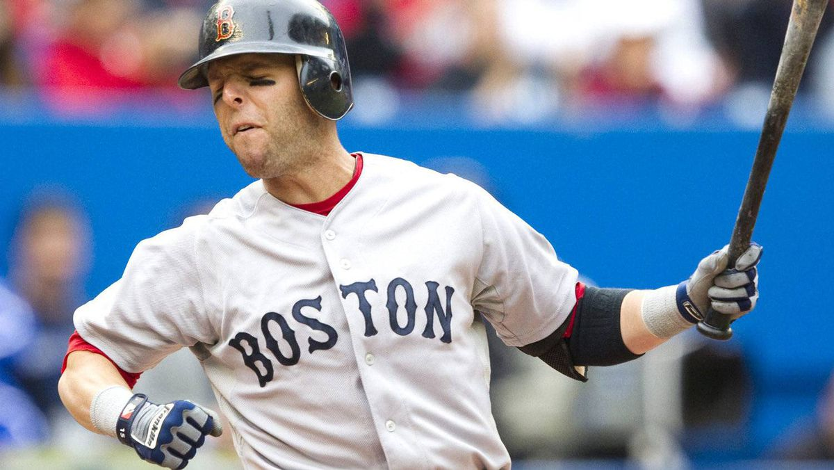 Boston Red Sox's Dustin Pedroia reacts after striking out in the 10th inning . THE CANADIAN PRESS/Darren Calabrese