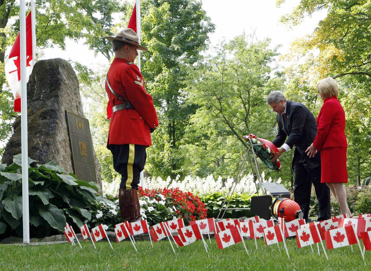 Prime Minister Stephen Harper lays a wreath with Maureen Basnicki, whose husband Ken was killed at the World Trade Center on Sept. 11, 2001.