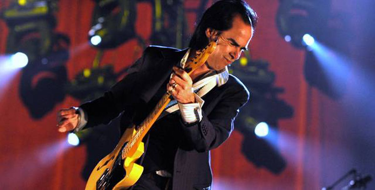 Australian singer Nick Cave performs in Germany, in June. Cave with his longtime collaborator Warren Ellis, have composed the score to the film The Road, premiering at TIFF.