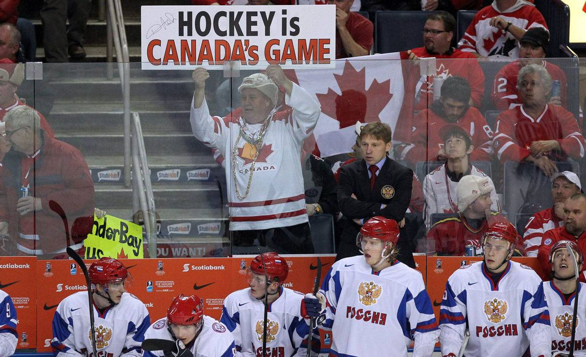 A Team Canada fan holds a sign over the Team Russia bench during second period IIHF World Junior Championship gold medal final hockey action in Buffalo, N.Y. on Wednesday, January 5, 2011.