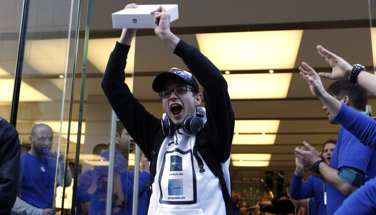 Christof Wallner, 23, from Austria, the first new iPad buyer in Germany, poses after purchasing the tablet in front of the Apple store in Munich March 16, 2012.