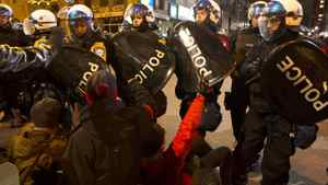 Protesters are confronted by police as they march against student tuition hikes in downtown Montreal, Quebec April 27, 2012.
