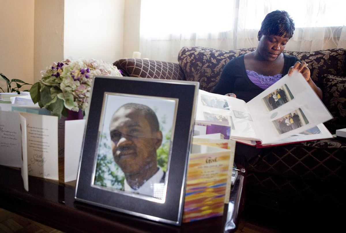 Clemee Joseph looks through a photo album of her son, 18-year-old Jarvis St. Remy, who was shot and killed May 1 at Dundas Street West and Howland Road.
